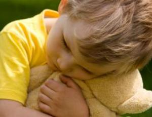 Child hugging stuffed animal